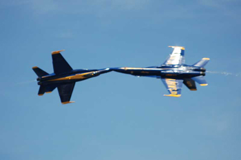 Two F/A-18s pass closs by going in opposite directions