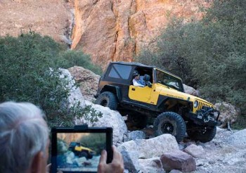 iPad taking video of a Jeep