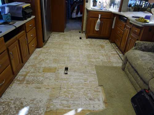 Demolotion of the old carpet and tile